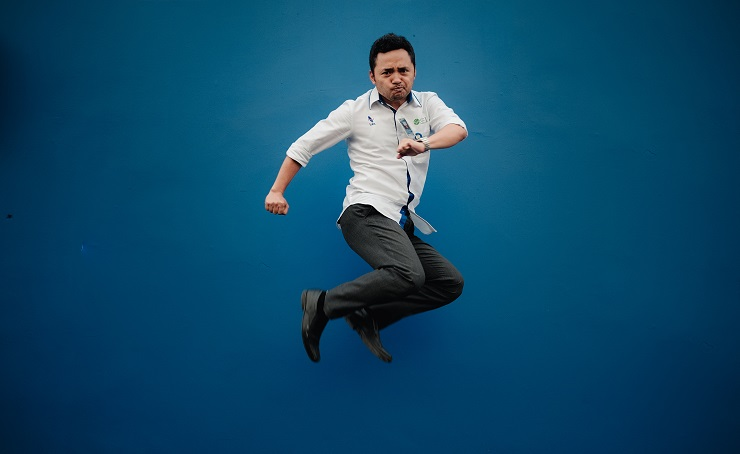 Man jumping with Blue Background